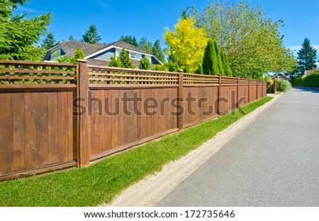 Long wooden cedar fence on the empty street. #172735646