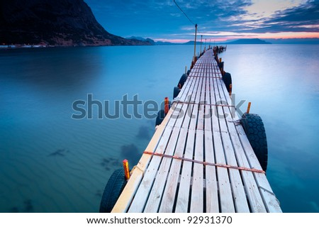 Long Wooden Dock and sea at Sunrise