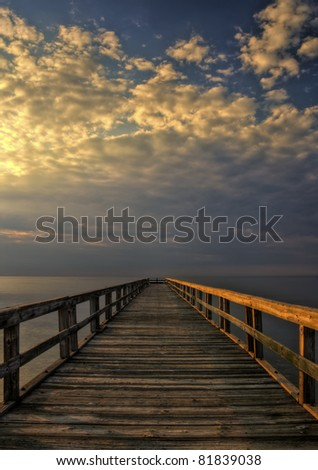 Long wooden fishing pier at Port Mahon, Delaware extending over the Delaware Bay.