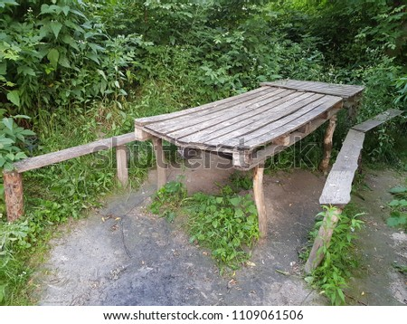 Long wooden old table and old benches in the forest #1109061506