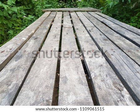 Long wooden old table and old benches in the forest #1109061515