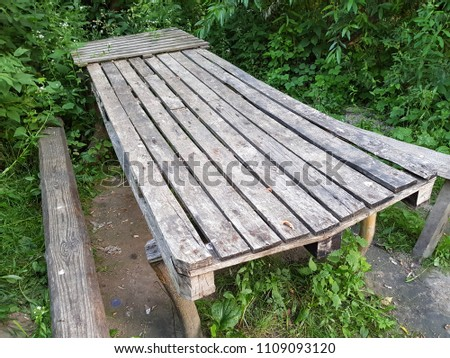 Long wooden old table and old benches in the forest #1109093120