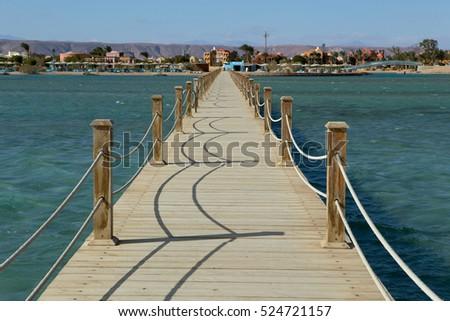 Long wooden pier into the sea. El Gouna. Egypt. #524721157