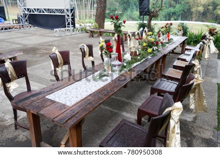 Long Wooden Tables Decorative In The Garden With Row Of Wooden Chairs.  Preparation For Outdoor