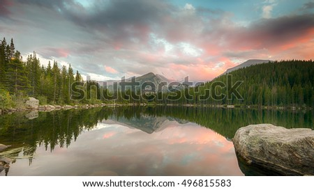 Longs Peak reflection in Bear Lake at dusk, in Rocky Mountain National Park, near Estes Park, Colorado. Stock photo ©