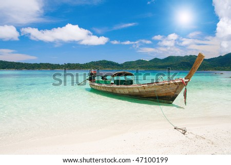 longtail boat and beautiful beach with white sand