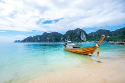 Longtail boat docked on the Sand Beaches at Ton Sai Pier on the Phi Phi Island, Krabi, Thailand.
