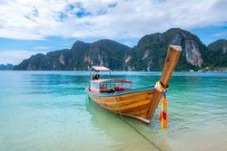 Longtail boat docked on the Ton Sai Beach on the Phi Phi Island, Krabi, Thailand.