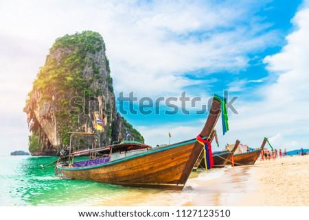 Longtail boat parked on natural sea beach waiting travelers, Ao nang beach, Andaman sea, Krabi near Phuket, Water travel Thailand, Tourism beautiful destination Asia, Summer holiday vacation trip
