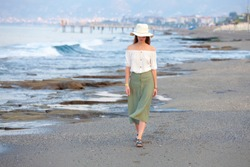 Lonley attractive woman walking at the beach