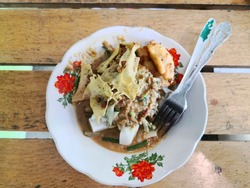 Lontong Pecal with Rempeyek is the traditional food from Indonesia. Taken at Tanjungpinang City on 06 September 2020.