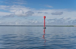 Loodsman or navigation pilot. The sea markers that indicate the route on the water. Baltic sea between tiny island Abruka and Roomassare port. Sign post that helps navigate to the harbor.