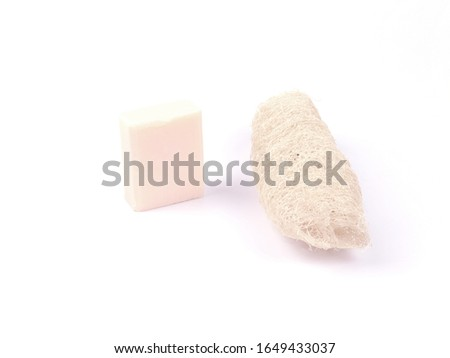 Loofah and soap is placed on a separate white background.