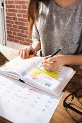 Look At Calendar Schedule Agenda Or Organizer At Desk