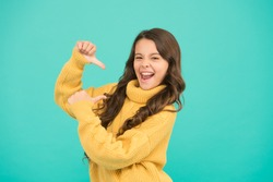 Look at me. Lucky kid. Positivity concept. Emotional baby. Positive child. Positive attitude to life. Positive mood. Kids psychology. Adorable smiling girl wear yellow sweater turquoise background.