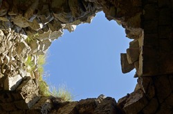 Look at the blue sky through the hole in the cave