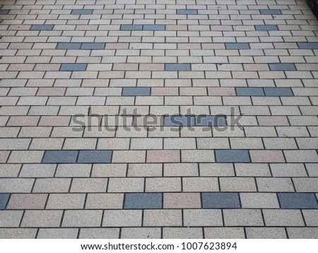 Look down at Japan footpath titles - Colorful rectangle block orderly align. #1007623894