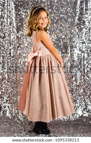 Look, hairdresser, makeup. Fashion model on silver background, beauty. Little girl in fashionable dress, prom. Child girl in stylish glamour dress, elegance. Fashion and beauty, little princess. #1095338213