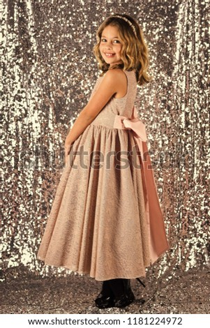 Look, hairdresser, makeup. Fashion model on silver background, beauty. Little girl in fashionable dress, prom. Child girl in stylish glamour dress, elegance. Fashion and beauty, little princess #1181224972