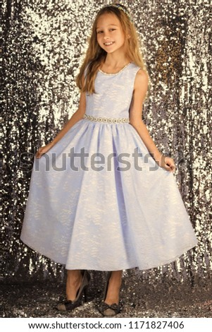 Look, hairdresser, makeup. Little girl in fashionable dress, prom. Child girl in stylish glamour dress, elegance. Fashion and beauty, little princess. Fashion model on silver background, beauty. #1171827406