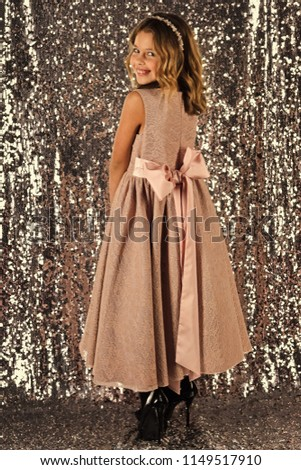 Look, hairdresser, makeup. Little girl in fashionable dress, prom. Fashion model on silver background, beauty. Child girl in stylish glamour dress, elegance. Fashion and beauty, little princess #1149517910