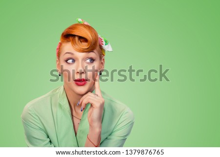 Look here aside. Closeup red head young woman pretty amazed pinup girl green button shirt excited surprised shocked looking to side retro vintage 50's hairstyle eyes mouth open. Human face expression