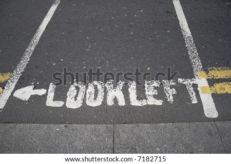 Look left sign on asphalt road in Dublin