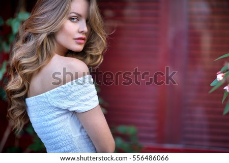 look of the sexy girl on a red background