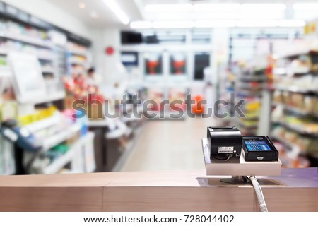 Look out from the payment counter, blur image of inside the convenience store as background. #728044402