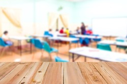 Look out from the table, blur image of classrooms as background.