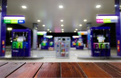 Look out from the table, to see gas station ,use for product presentation related Images.