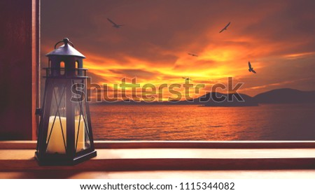 Look out the window, there is a candle (lighthouse shape) placed on the left side. Exterior overlooking the sea. Red orange sky There are small islands. And seagulls flying. (twilight) #1115344082