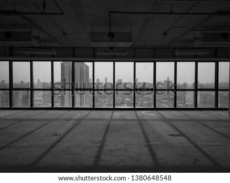 look outside from large glass window frame to see a city panoramic #1380648548