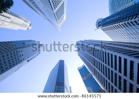Look to the sky surrounded by skyscrapers