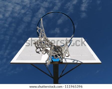 Look up at a basketball hoop.