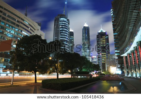 Look up to Shanghai Lujiazui city landmark modern buildings background night - stock photo