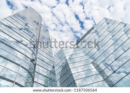 Look up view of modern skyscrapers glass building with cloud reflection #1187506564