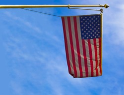 Looking at an American flag hanging on a building in Alexandria, Virginia.