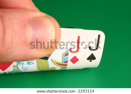 Looking at pocket Jacks (hooks) during a poker game