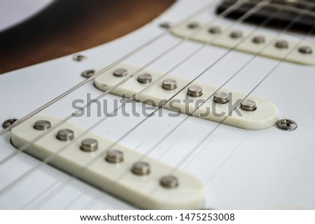 Looking at the strings of a guitar.