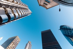 Looking directly up at the skyline of the financial district in the City of London