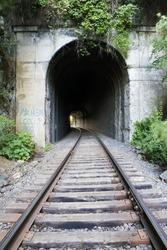 looking down a dark train tunnel