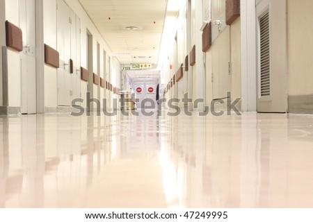 Looking down a hospital hall way