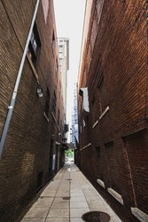 Looking down a tall narrow alley