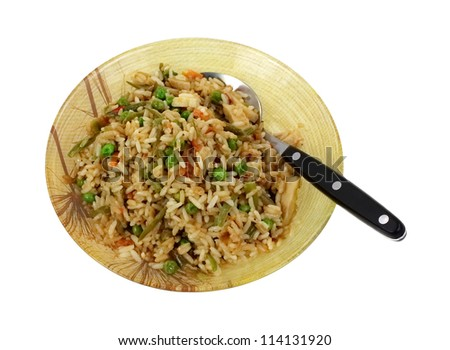 Looking down at a bowl of stir fried chicken, vegetables and rice.