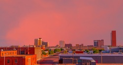 Looking down at the downtown district with a brilliant sunset creating color everywhere in Lubbock, Texas.