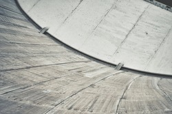 Looking down from a high concrete dam structure.