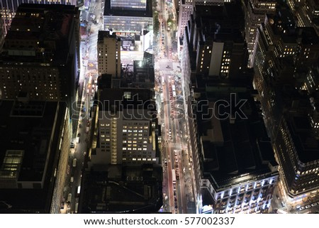 Looking down on Midtown Manhattan from a high vantage point.  Looking down on New York at night, cars driving down Manhattan streets. #577002337