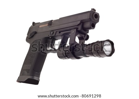 Looking down the barrel of a large 9mm automatic pistol with flashlight