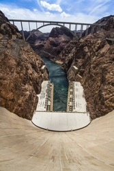 Looking down the Hoover Dam with a view of the Highway 93 bridge